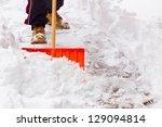 Shovel Being Pushed Through Snow