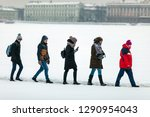 Small photo of Russia,Saint-Petersburg, Peter and Paul fortress, 19.01.2019, Baptism, people go to bathe in the ice, silhouettes of people, people walking on snow, winter walk, walk, one after the other