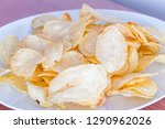 a pile of salted potato chips. | Shutterstock . vector #1290962026