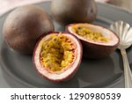 passion fruits on wooden... | Shutterstock . vector #1290980539