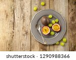 passion fruits on wooden... | Shutterstock . vector #1290988366