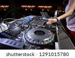 female disc jockey plays set on ... | Shutterstock . vector #1291015780