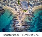 beautiful beach and rocky... | Shutterstock . vector #1291045273