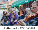 Small photo of BELFAST, NORTHERN IRELAND - JULY 31: Traditional fiddle players perform an impromptu jam at the Sunflower Public House. September 31, 2018 in Belfast, Northern Ireland.