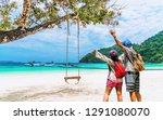 happy couple travelers joy... | Shutterstock . vector #1291080070