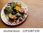 beautiful served food on plates ... | Shutterstock . vector #1291087150