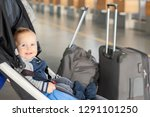 Small photo of Cute funny caucasian baby boy sitting in stroller near luggage at airport terminal. Child sin carriage with suitcasese near check-in desk counter. Travelling with small children concept