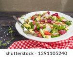 fresh salad with mixed greens ... | Shutterstock . vector #1291105240