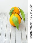 oranges on old wooden table   Shutterstock . vector #129117059