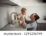 funny baby 6 months bathing in... | Shutterstock . vector #1291256749