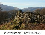 old drystone wall lit with... | Shutterstock . vector #1291307896