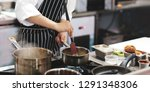chef cooking food in the... | Shutterstock . vector #1291348306