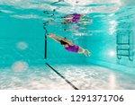 woman diving underwater in...   Shutterstock . vector #1291371706