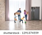 happy family with moving boxes... | Shutterstock . vector #1291374559