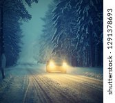 snowy winter road with car....   Shutterstock . vector #1291378693