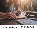 carpenter working with... | Shutterstock . vector #1291396069