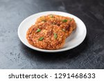 cutlets lie on a white plate.... | Shutterstock . vector #1291468633
