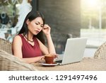 serious asian woman sitting at... | Shutterstock . vector #1291497496