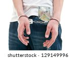 Man With Handcuffs And Bills In ...