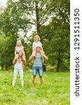 children ride piggyback on the... | Shutterstock . vector #1291511350