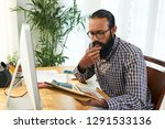 pensive young casual programmer ... | Shutterstock . vector #1291533136
