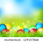 painted easter eggs lying in... | Shutterstock . vector #129157868