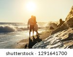 happy young couple standing on... | Shutterstock . vector #1291641700
