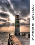 Dramatic Lighthouse With Light