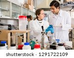 two young lab technicians... | Shutterstock . vector #1291722109