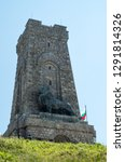 Monument to Freedom Shipka - Shipka, Gabrovo, Bulgaria. The Shipka Memorial is situated on the peak of Shipka in the Balkan Mountains near Gabrovo, Bulgaria. Summer view against the blue sky. Lion.