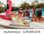cheerful crew enjoying at the... | Shutterstock . vector #1291851376