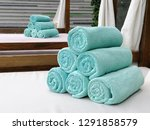 rolled up green towels on... | Shutterstock . vector #1291858579