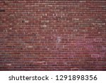 background of red brick wall... | Shutterstock . vector #1291898356