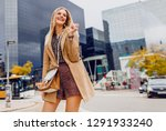 happy blond woman  in spring... | Shutterstock . vector #1291933240