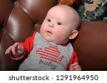 cute newborn baby in red and... | Shutterstock . vector #1291964950