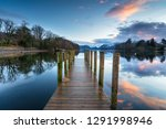 Sunset Over A Wooden Jetty On...