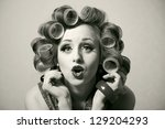 funny girl with hair curlers on ... | Shutterstock . vector #129204293