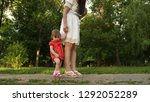 mom and little daughter are... | Shutterstock . vector #1292052289