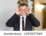 funny groom trying out the... | Shutterstock . vector #1292057569