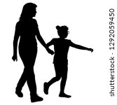 silhouette of happy family on a ... | Shutterstock . vector #1292059450