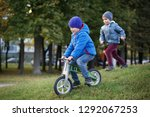 one child rolls on a runner and ... | Shutterstock . vector #1292067253