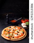 pizza margarita and pepperoni | Shutterstock . vector #1292213386