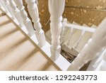 white staircase with wooden... | Shutterstock . vector #1292243773