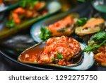 mussel cooking pan seafood... | Shutterstock . vector #1292275750