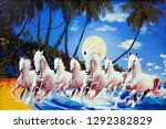 Stock photo seven running horses in blue background canvas texture oil painting 1292382829