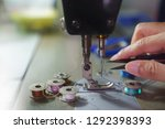 woman working on a sewing... | Shutterstock . vector #1292398393
