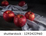 fresh red apples on wooden table | Shutterstock . vector #1292422960