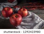 fresh red apples on wooden table | Shutterstock . vector #1292423980