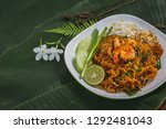 pad thai noodles on white plate ... | Shutterstock . vector #1292481043