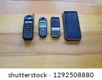 A Row Of Old And New Mobile...